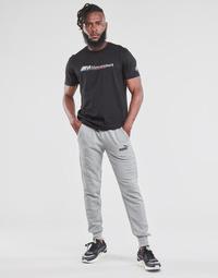 textil Hombre Pantalones de chándal Puma ESS LOGO SLIM PANT LOGO FL CL Gris